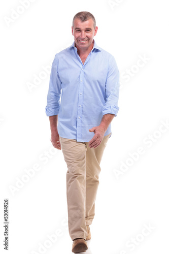 casual middle aged man walks to the camera