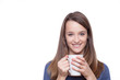 Portrait of a cute young lady with a cup of coffee..