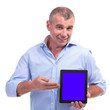 casual middle aged man presenting tablet