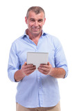 casual middle aged man holds tablet