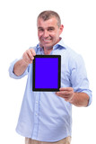 casual middle aged man shows his tablet