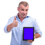 casual middle aged man recommends a tablet