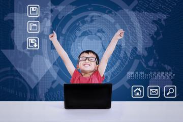Asian boy winning using laptop on blue background