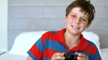Concentrated young boy playing video games