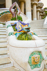 Colorful mosaic dragon in the fountain of park Guell, designed b