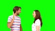 Friends giving high-five on green screen