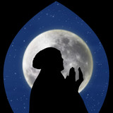 Close-up of female muslim pray on blue moon