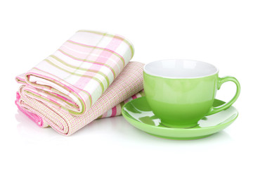 Coffee cup and kitchen towels