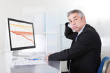 Confused Businessman With Computer