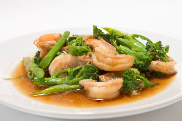 Prawns with broccoli fried sauce on white dish