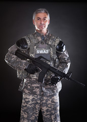Portrait Of A Mature Soldier Holding Gun