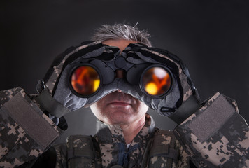 Mature Soldier Looking Through Binoculars