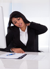 Businesswoman In Pain Holding Her Neck