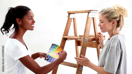Attractive friends wondering what colour choose for the wall