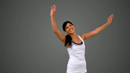 Fit brunette stretching and waving