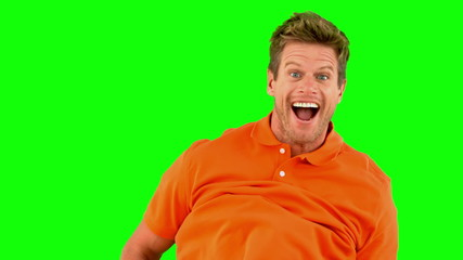 Handsome man jumping on green screen