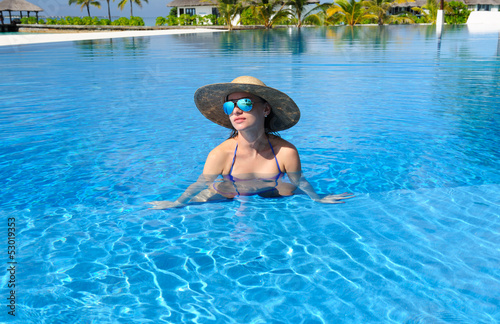 Woman at poolside