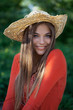 Cute girl in a straw hat