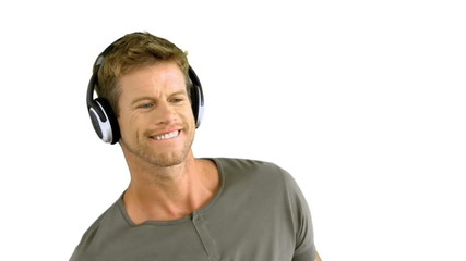 Attractive man with headphones listening to music
