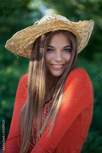 Cute girl in a straw hat