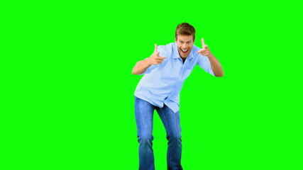 Man skating and pointing at camera on green screen