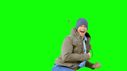 Man jumping and turning on green screen