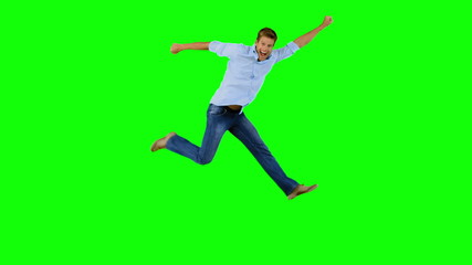 Man jumping and gesturing on green screen