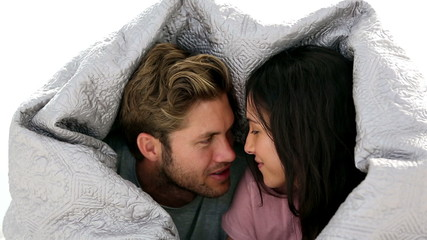 Couple chatting under the covers
