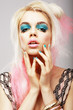 Eccentric Blond with Theatrical Cyan Makeup. Dyed Pink Hair