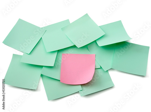 A pink and green  notes, isolated on white background