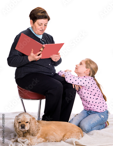 Grandmother reading a novel to her granddaughter