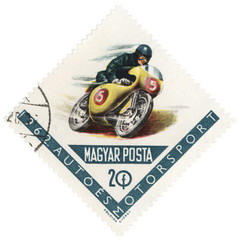 Riding motorcyclist on post stamp