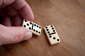 Hand with domino.