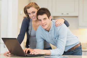 Happy couple on laptop
