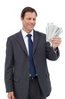 Smiling businessman holding bills