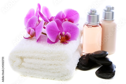 Set basalt stones, towel and orchid.