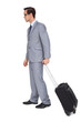 Young businessman with glasses holding a trolley