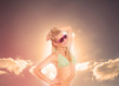Blonde woman enjoying sunbathing in bikini