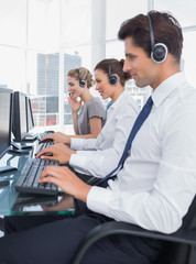 Group of call center employees working in line