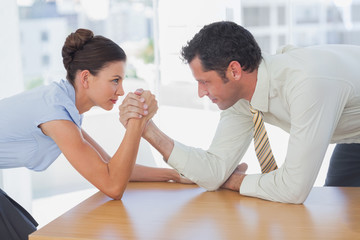 Business people arm wrestling