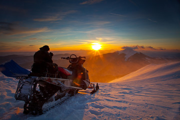 The snowmobile on a beautiful winter landscape