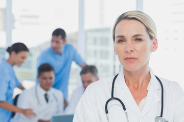 Serious doctor standing