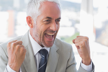 Succesful businessman cheering