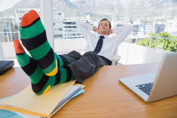Businessman having a nap with feet on the desk