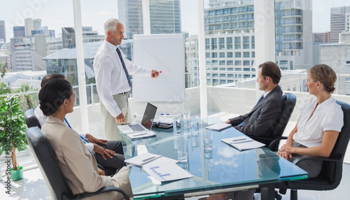 Manager pointing at a chart during a meeting