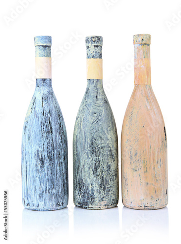 Old bottles of wine, isolated on white