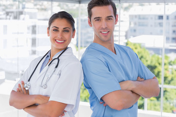 Medical staff standing with arms crossed