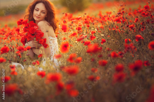 The bride  in a poppy field