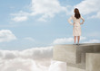 Businesswoman looking at the horizon over the clouds