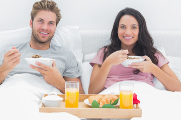 Couple eating cereal during a romantic breakfast